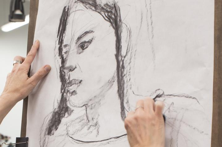 photo of hands of Nancy Hanner working on portrait drawing - Fine Arts Institute
