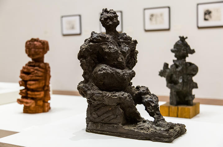 "photo of ""Semi-Aggressive"" by Reuben Kadish and surrounded by 2 other sculptures"