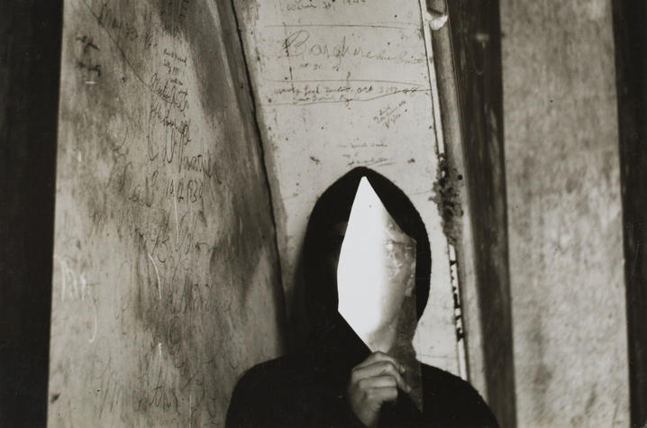 "photo of ""Untitled"" image of man with reflected glass in front of face by Ralph Eugene Meatyard"