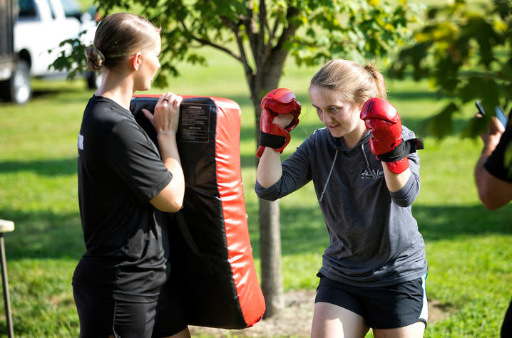 photo of female preparing to punch bag