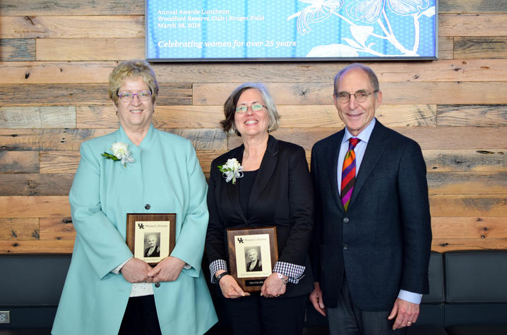 photo of Sarah Bennett Holmes Award winners Debra Moser and Lisa Collins with UK President Eli Capilouto.