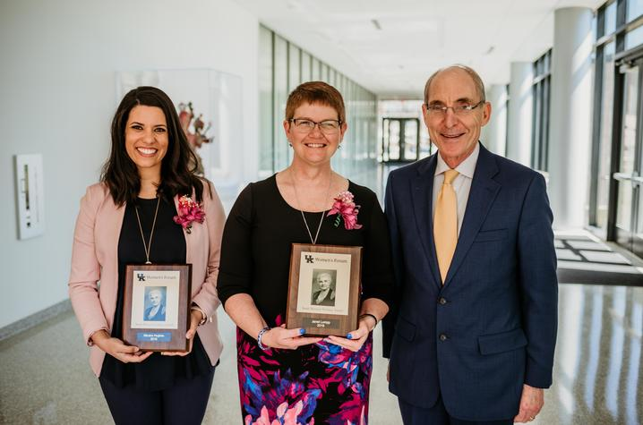 photo of 2019 Sarah Bennett Holmes Award winners Micaha Hughes and Janet Lumpp with UK President Eli Capilouto