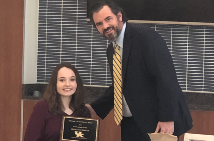 Lindley Barker accepting the Brent Scholarship  at the 2019 DRC recognition ceremony.