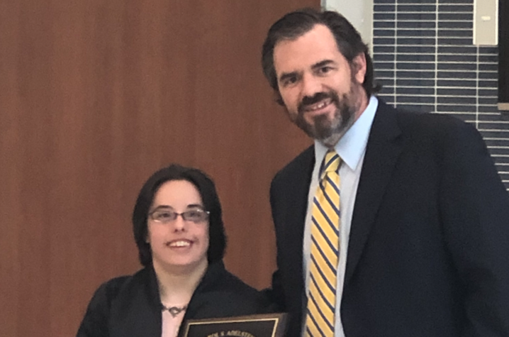 Megan McCormick (left) receiving the Adelstein Award during the DRC's annual recognition ceremony.