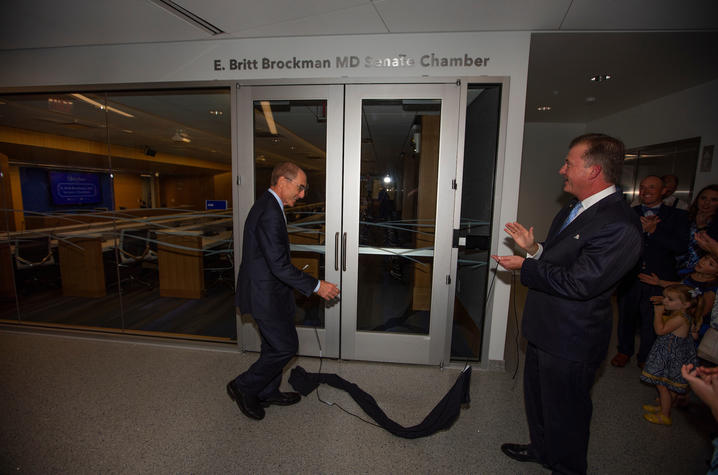 photo of UK President Eli Capilouto and Board Chair Britt Brockman after unveiling of name over Senate Chamber door.
