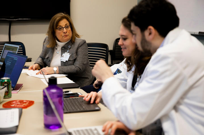 Dr. Carol Hustedde leads TEAM Clinic participants in a discussion on collaborative care