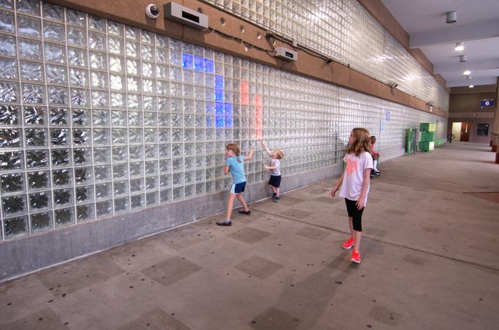 photo of children with LED installation created by UK College of Design