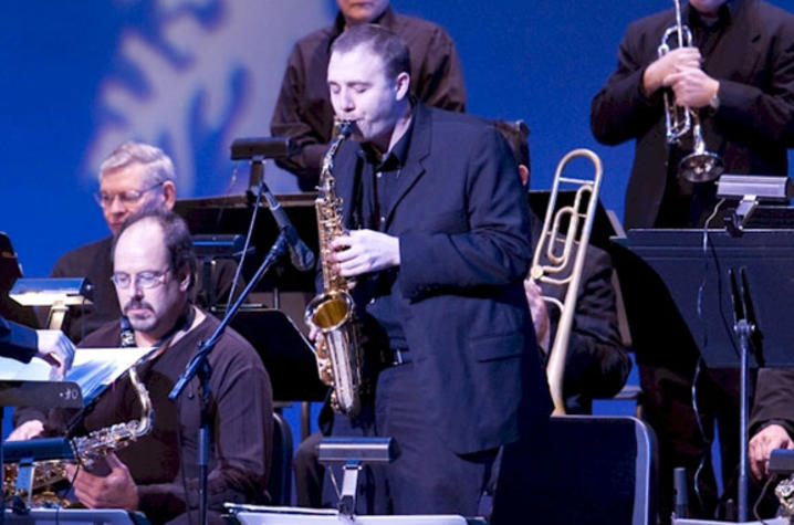 photo of BAJA sax player soloing at holiday concert