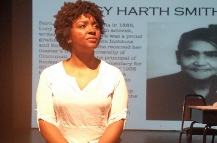 """photo of Lacresha Berry on stage in a performance of """"Browngirl. Bluegrass."""""""