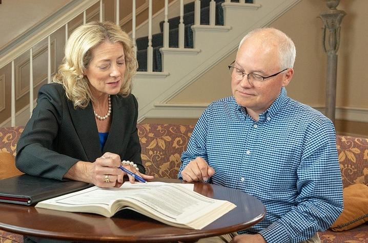 Caroline Francis and a gentleman review a publication in UK Alumni Career Services. Photo by Hal Morris.