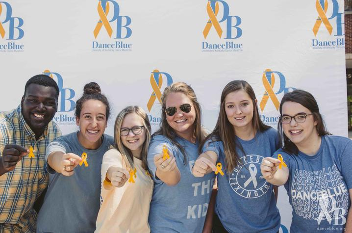 DanceBlue volunteers hold out yellow ribbons