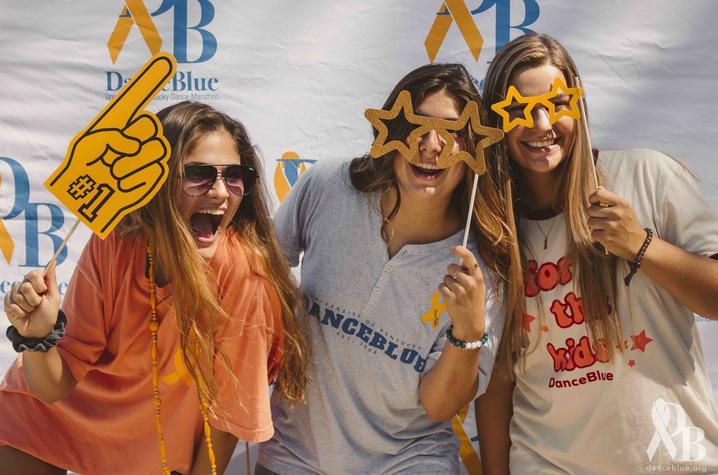 DanceBlue volunteers pose with yellow props