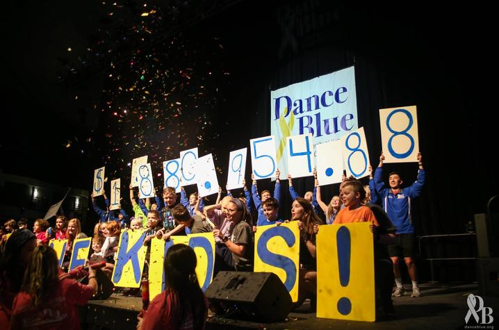 DanceBlue participants hold up fundraising total