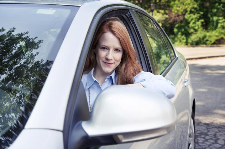 Woman in a car.