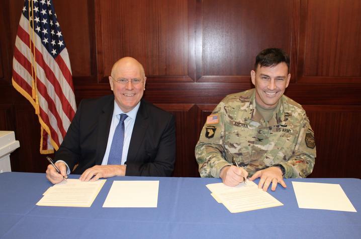 photo of David Blackwell and Col. Joseph Kuchan signing MOU