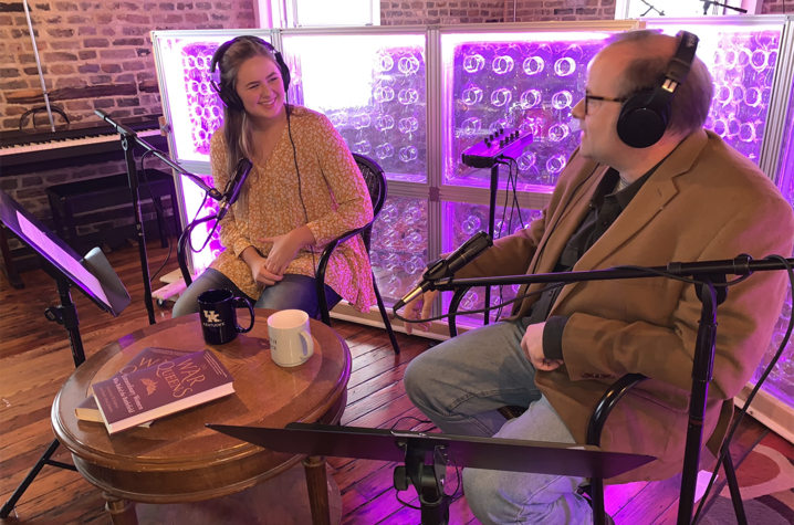 photo of student Emily Jordan recording podcast with her father