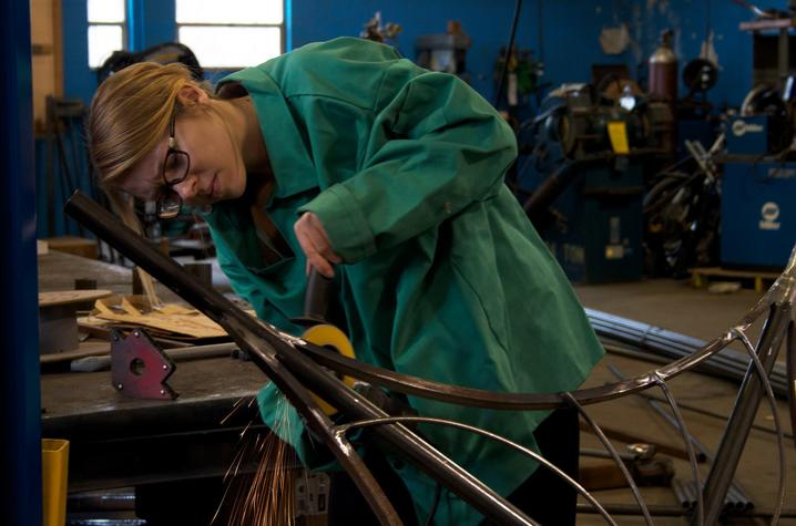 photo of Amy Hoagland working on sculpture