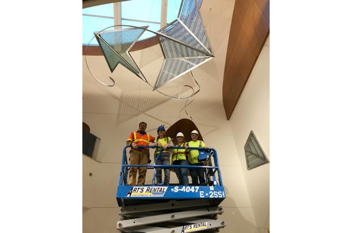 Photo of team installing the kites