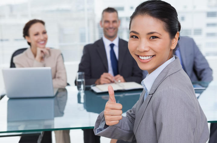 stock photo of job candidate at interview giving thumbs up