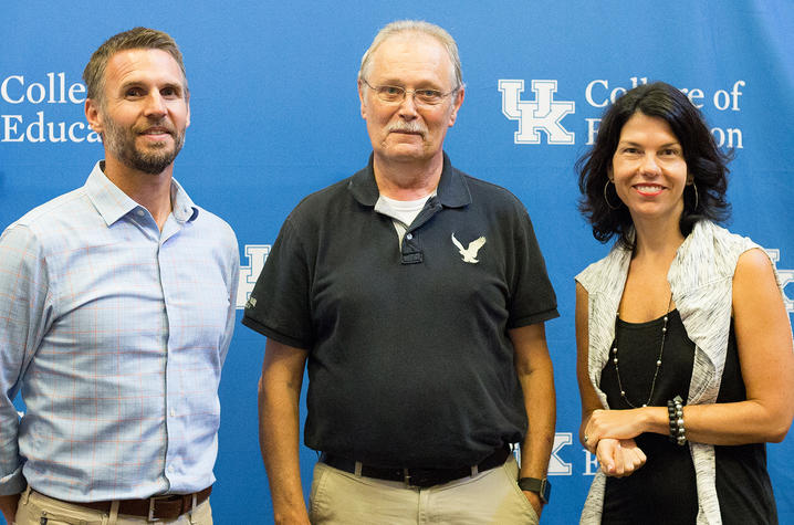 photo of  Ryan Crowley, assistant professor in the UK College of Education Department of Curriculum and Instruction, Lester Beaty, nephew of Private Joe Stanton Elmore, and Kathy Swan, professor in the Department of Curriculum and Instruction