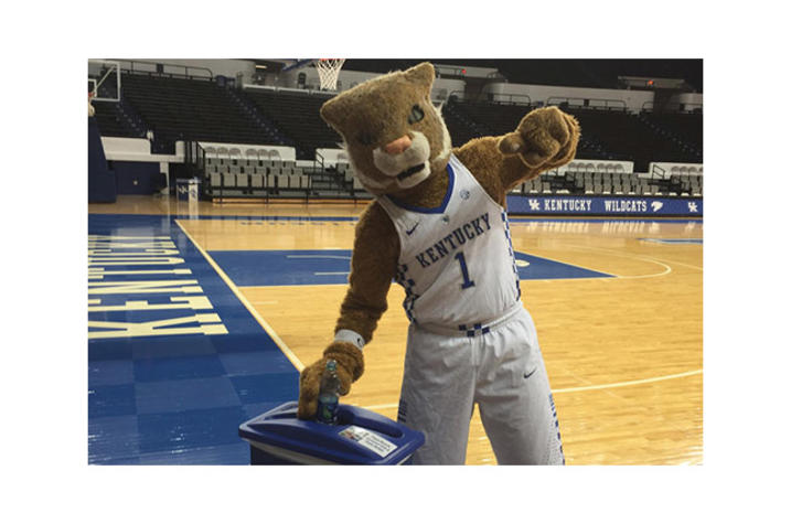 the wildcat recycling a bottle