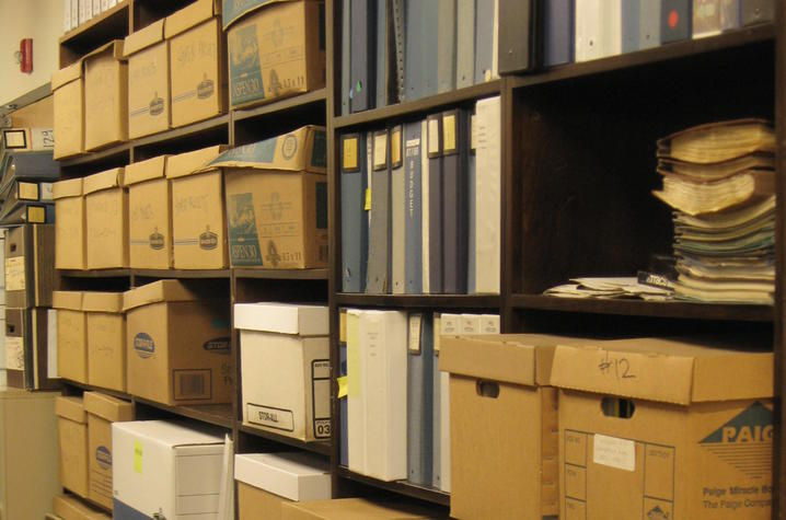 photo of shelves of boxes and binders