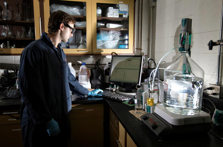 photo of young man in a lab