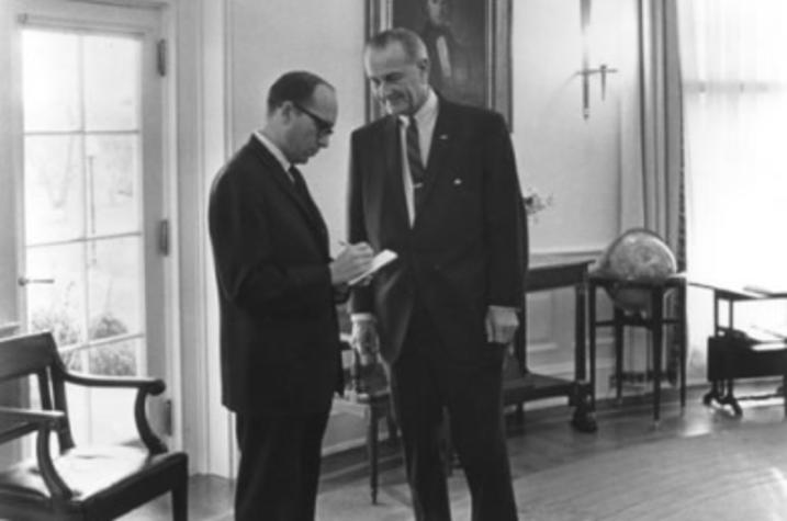 black and white photo of Sid Davis interviewing LBJ in White House
