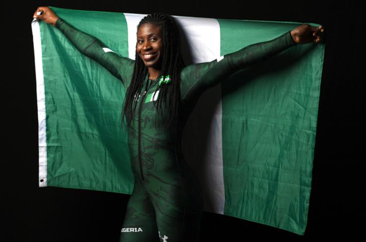 """The photo of Simidele """"Simi"""" Adeagbo holding the Nigerian flag."""