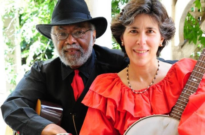 photo of Sparky and Rhonda Rucker holding instruments