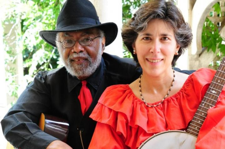 photo of Sparky and Rhonda Rucker holding instruments seated