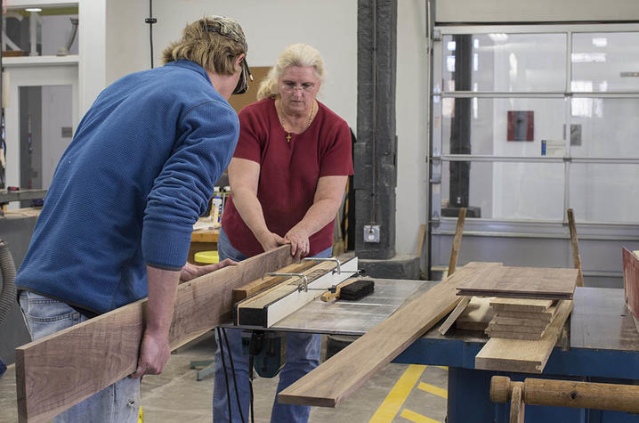 photo of 2 students in woodworking - Fine Arts Institute