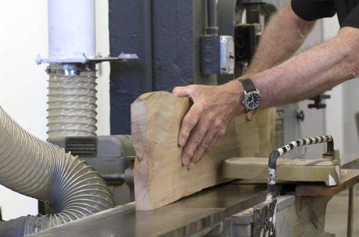 photo of a mans hands working in a woodworking class at Fine Arts Institute