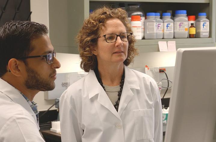 Madhur Agrawal, a postdoc in pharmacology & nutritional sciences, discusses findings with Barbara Nikolajczyk in her lab in the Wethington building.