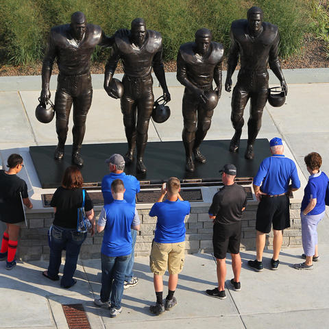 Statues outside the stadium at UK of the four football players who broke the color line in the SEC in the 1960s. From left to right, Greg Page, Nate Northington, Wilbur Hackett, and Houston Hogg.