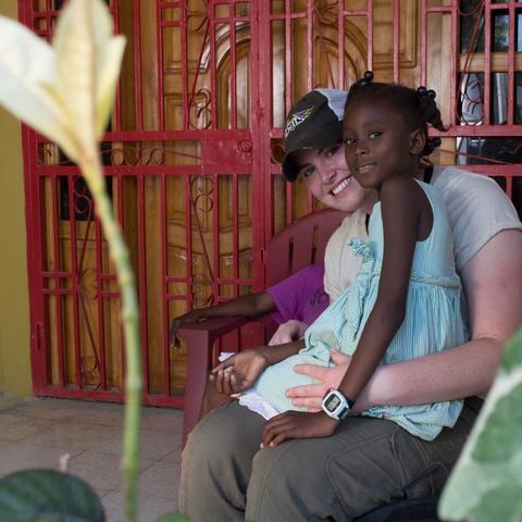 photo of UK student and child at Haiti orphanage