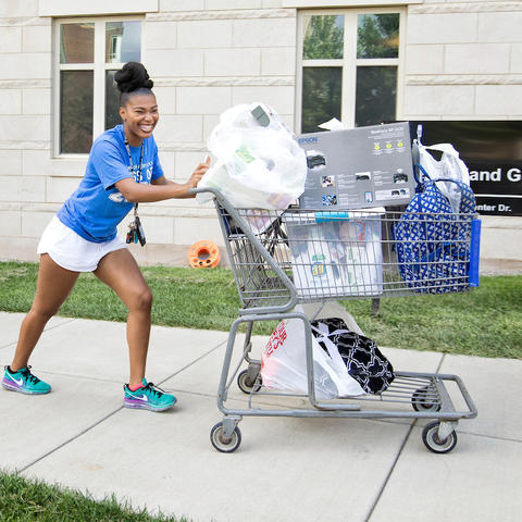 photo of student moving in to campus housing