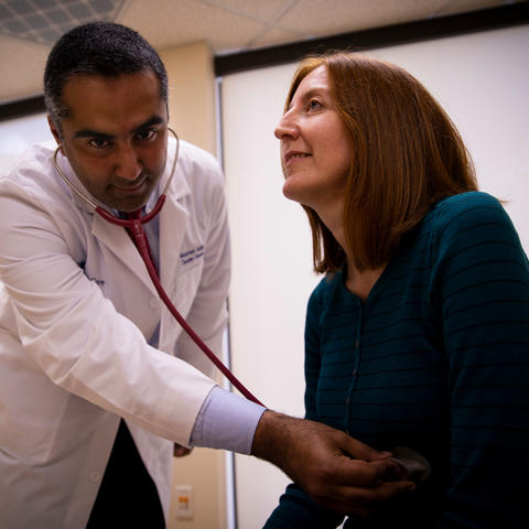 Dr. Moamen Gabr examines patient Jackie Denault