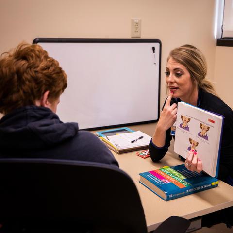 Speech-language pathologist Corie Sexton works with Gray McClanahan | Photo: Pete Comparoni