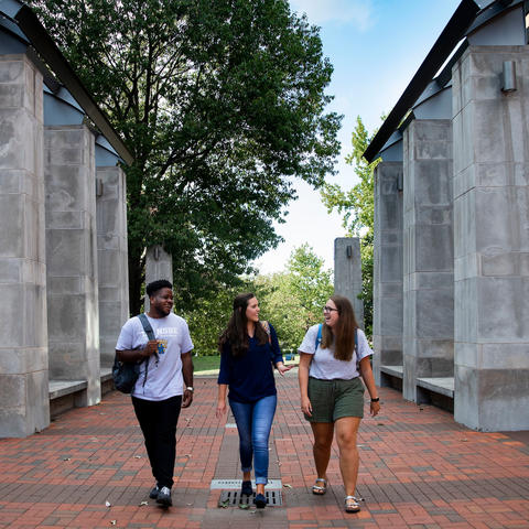 photo of 3 students walking in Engineering quad