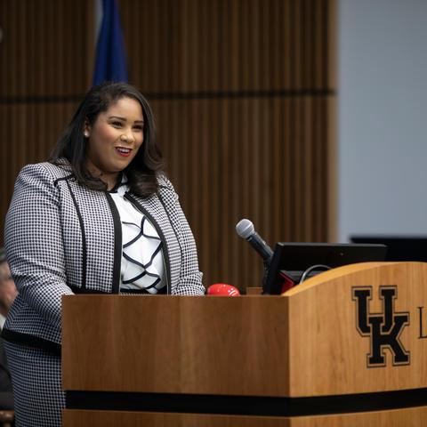 Chynna Hibbitts speaks at podium