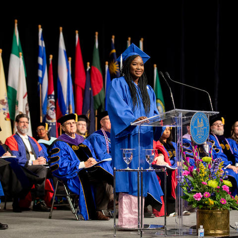 Photo of student speaker at December commencement