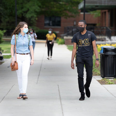 Photo of students wearing masks walking through campus