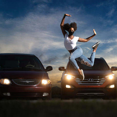 """photo of Connor Perry dancing in front of cars illuminated by cars for """"Once Vacant"""""""