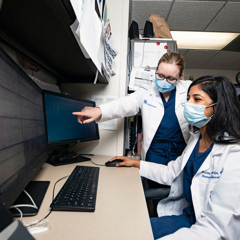 Photo of two residents working together at health care