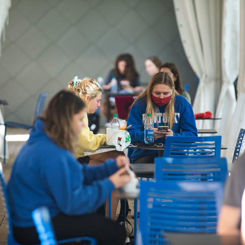 Photo of students eating together