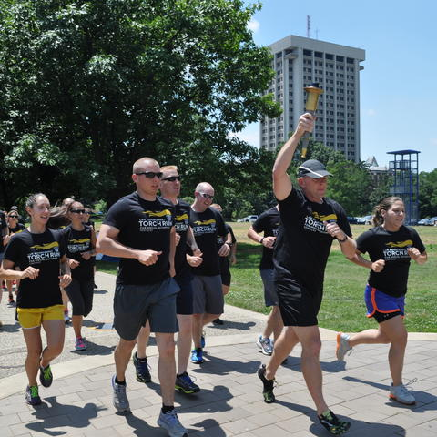 photo of UK Police officers running in Law Enforcement Torch Run in 2014