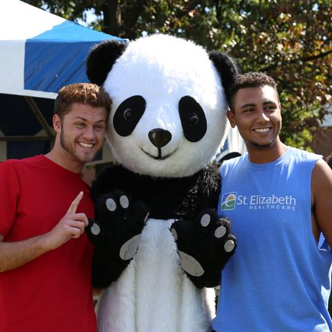 photo of 2 male students at Confucius Institute Day with panda