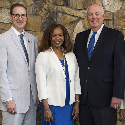 The UK Alumni Association officers for 2018-2019 are, from left, Timothy Walsh (secretary), Taunya A. Phillips (president-elect), J. Fritz Skeen (president); and Hannah Miner Myers (treasurer). Photo by Tim Webb