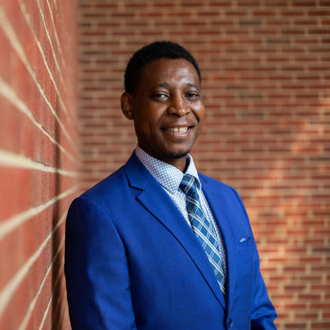 headshot image of Zim Okoli